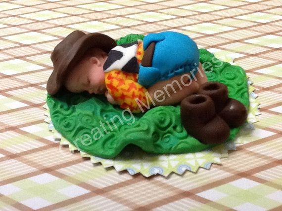 BABY SHOWER Edible Cake topper Baby Woody Or Cowboy made of Vanilla Fondant ready for your cake Baby Boots laying on a green blanket on Etsy, $20.88 AUD