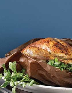 Roasting a turkey in a brown paper grocery bag creates a steamy environment that cooks the turkey quickly and produces extremely moist, flavourful meat.