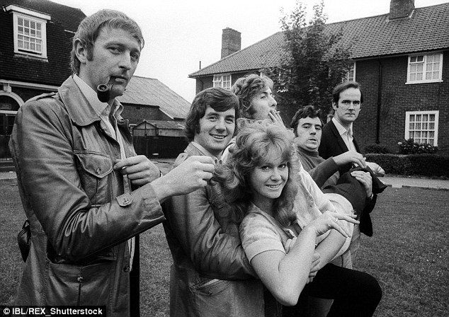 Altogether now: Graham Chapman, Eric Idle, special guest Carol Cleveland, Michael Palin, Terry Jones, John Cleese larking about as the comedy troupe in 1970