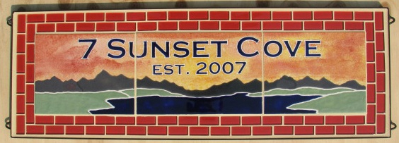 Sunset Cove- Custom designed tile mural with glass border. Available in a variety of sizes.