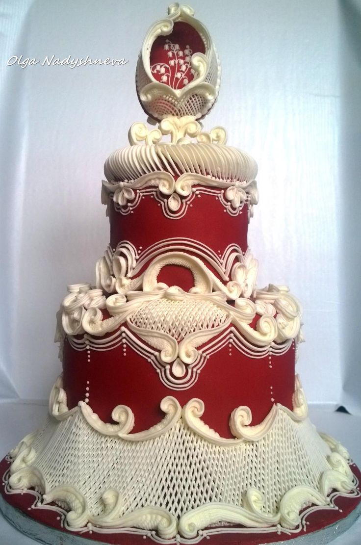 Elegant deep red and ivory are perfect in this extraordinary cake with royal icing over-piping.