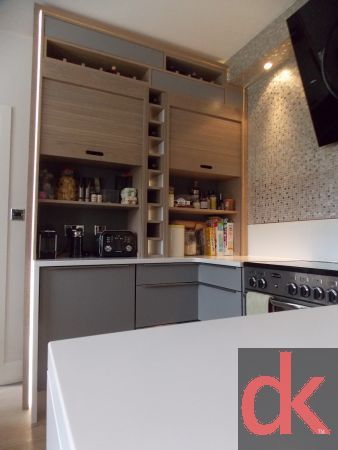 A contemporary kitchen remodel featuring some very cool but practical kitchen…