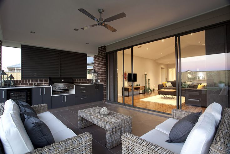 Can't wait to one day have an alfresco like this - BBQ area, ceiling fan and couches to enjoy a wine.