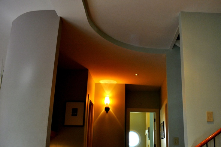 curving walls and ceiling flow playfully this space to define space and imply movement  photo by Jeff DuBro