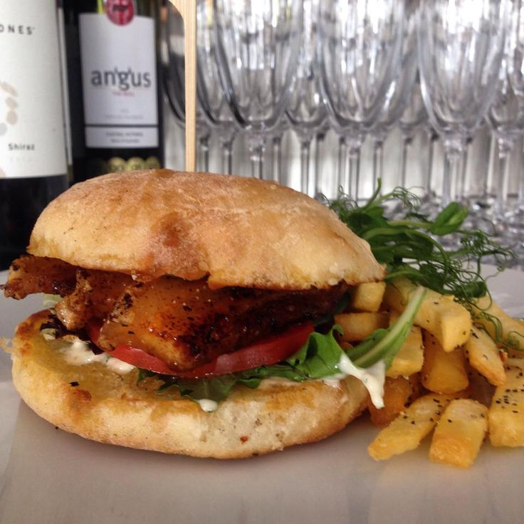 Howling's Bar $15 lunch special this week! Pork belly burger with a side of chips  http://www.howlings.bar/