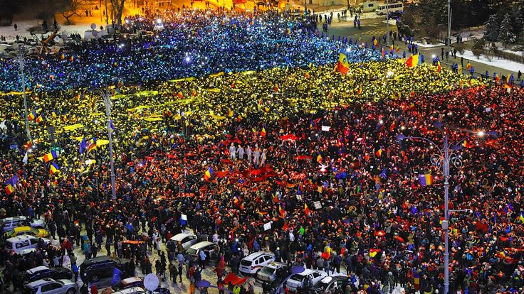 Thousands of protesters, demonstrating against corruption, held up lights in the color of the Romanian flag in the square outside the Romanian government offices Sunday. Photo: Associated Press