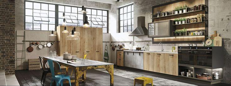 Cozinha industrial Loft da Snaidero utilizando de materiais vernaculares para a produção. É um tendências muito atual.