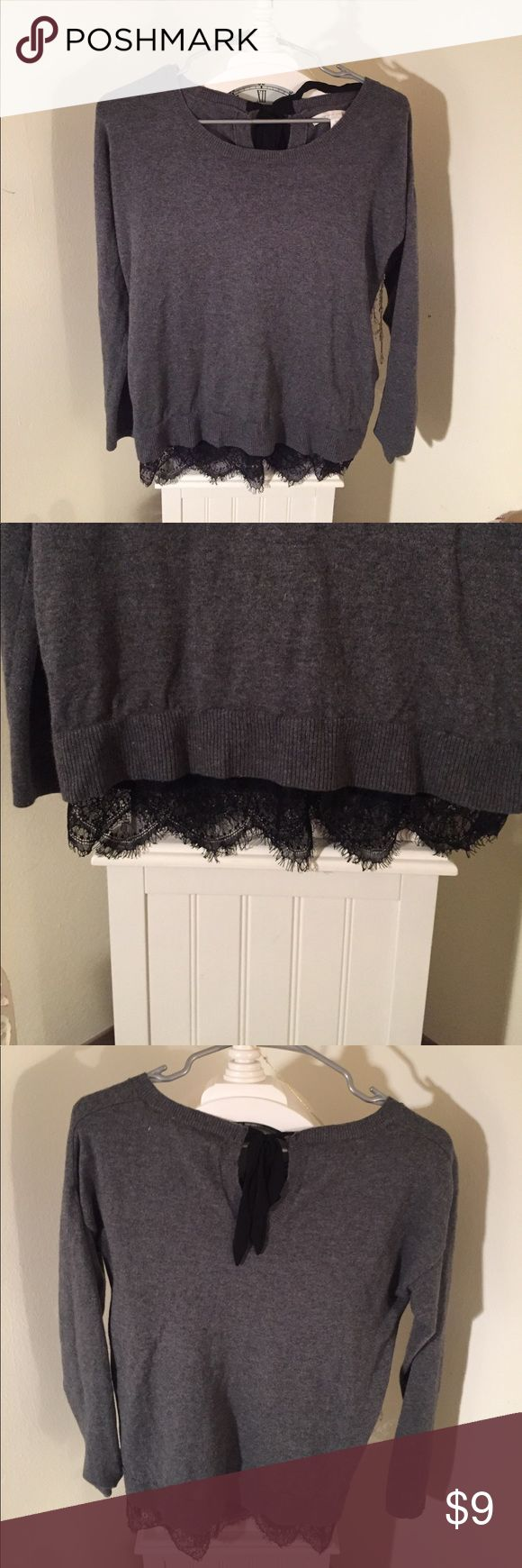 Laura Conrad sweater with black lace Great condition. Lauren Conrad sweater with bottom lace trim. Tie at top of neck in back. Size xs LC Lauren Conrad Sweaters Crew & Scoop Necks