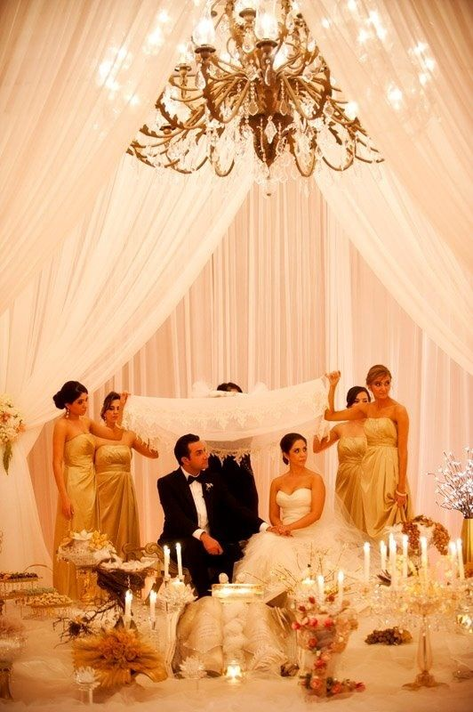 GOLD BRIDESMAIDS! Maybe than can carry those fan leaves instead of boquets? Persian wedding ceremony setup