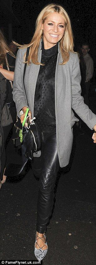 City chic:Tess Daly cut a stylish figure in leather pants and a classy grey overcoat during the night out