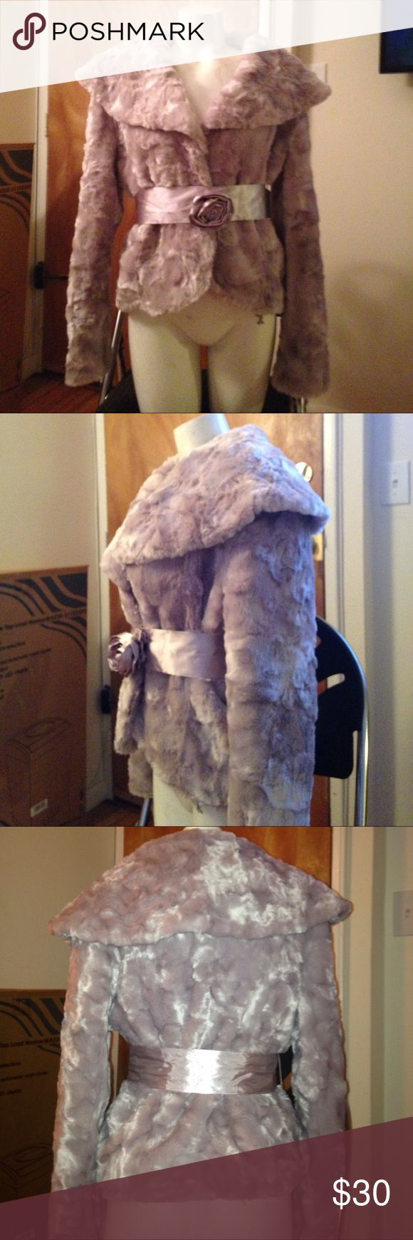Faux Fur Jacket Faux Fur bolero jacket with ribbon belt around waist. Flower on front of ribbon closure. Big collar. Missing 1 hook closure. Can easily be replaced. Satin lining on inside. Very Cute with jeans. Kenneth Cole Reaction Jackets & Coats