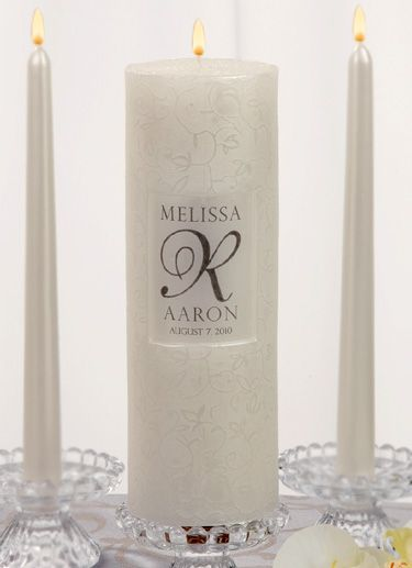 """Our Personalized Scroll Pattern Unity Candle Set will light up your unity candle ceremony beautifully.  This 3 piece unity candle set is available in white or ivory and is perfect for any couple who appreciates a classic style.  The unity pillar candle features a scroll pattern and free personalization.  Measures 9"""" H x 3"""" Diameter"""