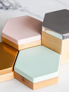 These would look fantastic as risers for a jewelry or small item display. High-gloss finishes like metal tiles, add pops of personal style.