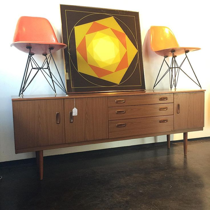 """Our 78"""" long Schreiber #sideboard is back in our warehouse ( $950) ... We have two authentic Eames chairs left from #fleastyle ($185 each) and the amazing mod #1960s art with brass frame ( $275) text Leslie for details 214-205-3409 #shopvintagedallas #vintage #midcentury #retro #sideboard #art #mod"""