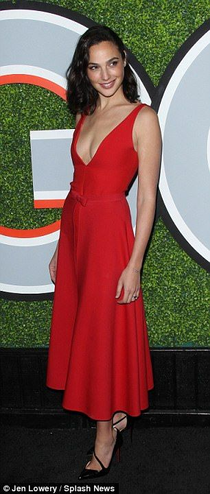 Work it: Her long red dress swept down toward her ankles, showing off a pair of strappy black heels