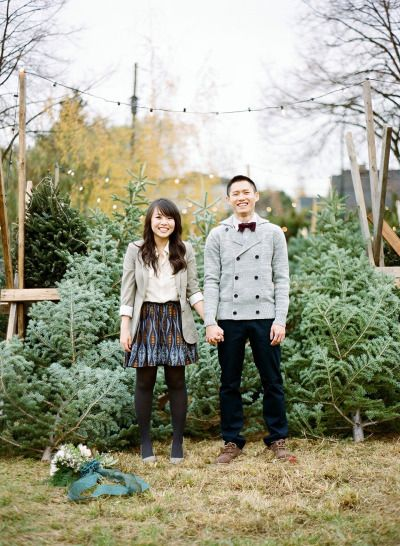 Christmas tree e-sesh: http://www.stylemepretty.com/2013/12/24/christmas-engagement-session/   Photography: Nadia Hung - http://nadiahungphotography.com/