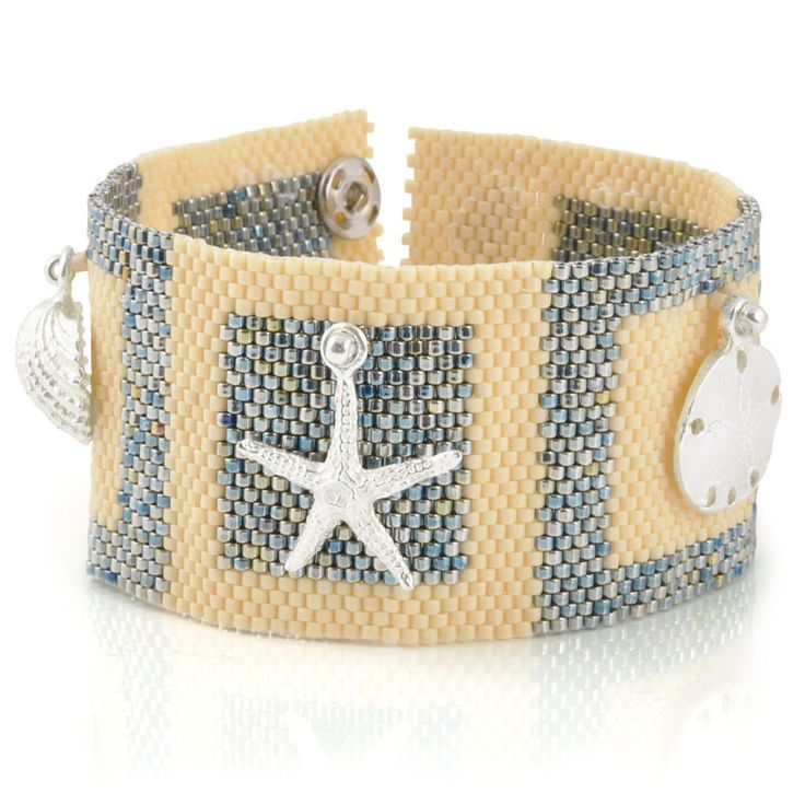 """""""Sandbox"""" features a peyote bracelet base. Focal charms are added to make an elegant cuff. This printed copy is 3 pages long and is full of detailed photographs and computer illustrations. """"Sandbox"""" B"""