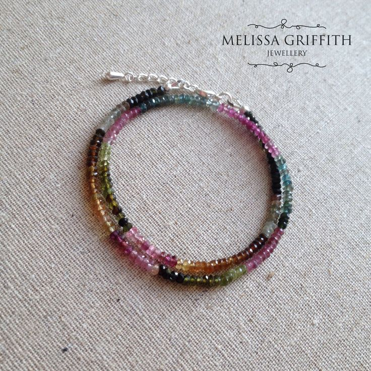 Tourmaline Double Wrap Bracelet (MGB82) $95.00  This bracelet features micro faceted tourmaline rondelles in colours ranging from shades of pink, dark green, gold, blue, black, and creamy white. So many colours that all blend together perfectly as they drape around your wrist. Beads are strung onto strong and flexible beading wire with a sterling silver lobster clasp closure. Includes a 1 inch extender for the perfect fit.