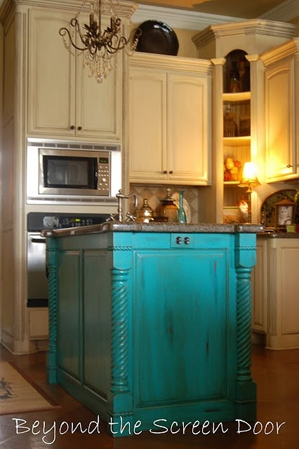 cream cabinets with a turquoise island.