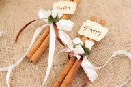 Wedding Favors for the guests on the tables, with tag names on.... Cinnamons, smell soooo nice.... by lenagamos.gr