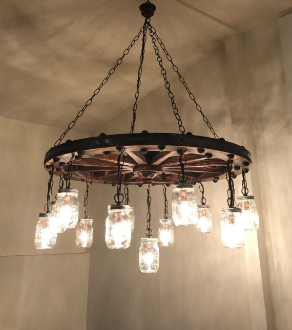 Wagon Wheel Chandelier with Mason Jar by RutherfordFixtureCo