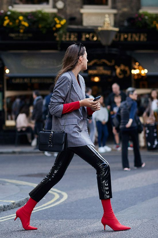 London fashion week street style—We're filing this under looks we'd like to copy. Checkered blazer + slick leather leggings + red sock boots.