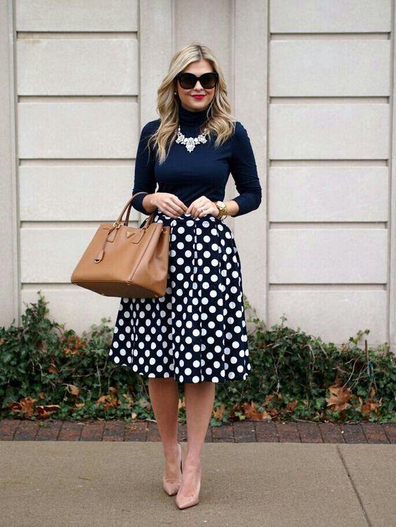 a navy turtleneck and a polka dot swing midi skirt, nude heels