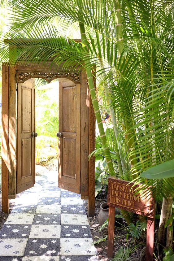 Carved TeakIndonesian Doors and Frame set the mood for the garden.                                                                                                                                                                                 More