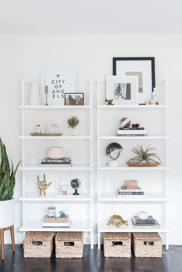 anne sage is known for her incredible styling these white bookcases on a white wall