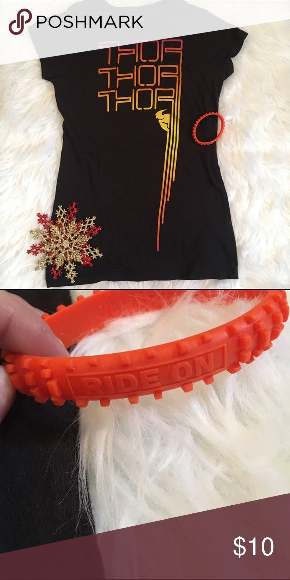 Motocross Top & Bracelet Includes Top & Bracelet. Orange motocross rubber bracelet. Black top with yellow, orange, pink ombré writing. Thor Racing. Motocross/quad/ATV brand. Brand new condition. Says medium but runs small and fits an XS best. (Not Fox) No trades. Price is firm unless bundled. 15% off of bundles of 3 or more. Fox Tops