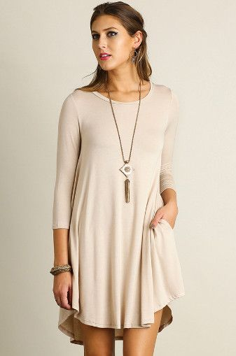 Scoop Neck T-Shirt Dress, Cappucino This Scoop Neck T-Shirt Dress features a scalloped hemline and pockets. A must have basic for every closet for Fall. So many outfit options with this one. - Wear it