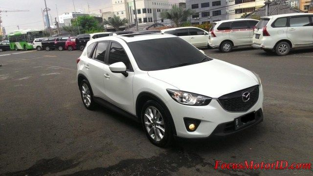 Mazda CX5 2.0 GT19 Pemakaian 2013   bln 2 Km31rb Record. Airbags. Keyless.  Sunroof. Electric Leather Heater Seats.  AudioBOSE. Camera. Audiosteer. Sensorparking.  Foglamp. VR19inch. KF3M.    Harga Termurah di : OTR 295JT  Hubungi Team FOCUS Motor:  (Chatting/Message not recommended )  Regina 0888.8019.102 Kenny 08381.6161.616 Jimmy 08155.1990.66 Rudy 08128.8828.89 Subur 08128.696308 Rendy 08128.1812.926