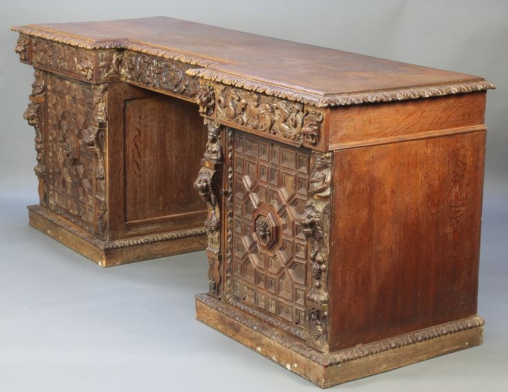 """Lot 909, A Victorian heavily carved oak inverted breakfront pedestal sideboard fitted 2 short drawers above cupboards enclosed by heavily panelled doors and with 1 long drawer to the centre, the left drawer carved ANNO and the right drawer carved 1674 38""""h x 92 1/2""""w x 31""""d est £150-200"""