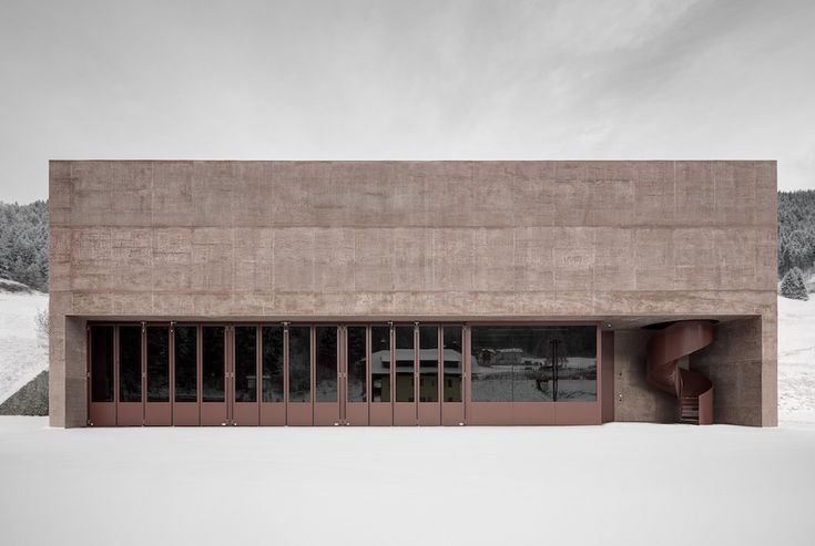 A Rose-Tinted Fire Station By Pedevilla Architects in South Tyrol.