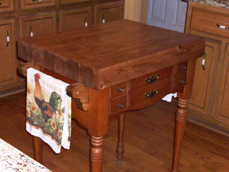 butcher block kitchen island from an old sewing machine cabinet