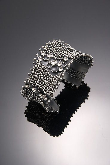 Cuff | So Young Park. 'Drop by Drop'.  Oxidized and sterling silver.