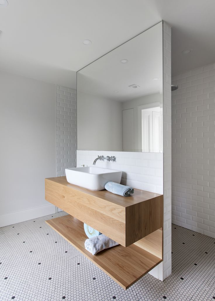 The bathroom will feature a large mirror over the vanity, which will give the illusion of a larger space. Light is also reflected from the the window on the opposite side.