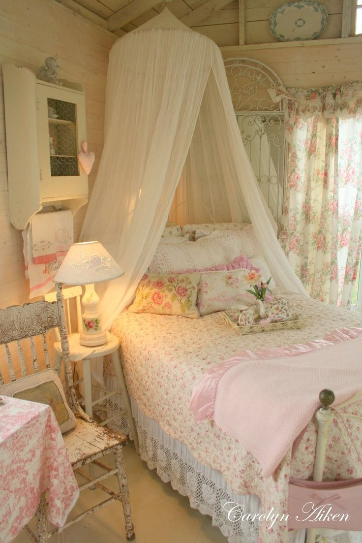Sweet Shabby Chic young ladies bedroom. The bed is angled in a 45 degrees angle which allows the canopy above the bed to feel cozy and protective over the bed. Just charming! By Carolyn Aiken.