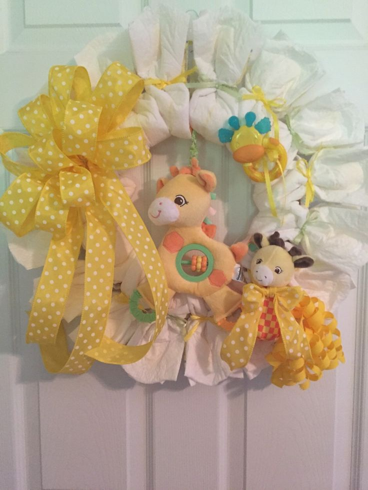 Diaper Wreath, Giraffe Diaper Wreath, Gender Neutral, Hospital Door Wreath, Baby Shower Wreath, Welcome Baby Wreath, Wreath by RoesWreaths on Etsy https://www.etsy.com/listing/238639533/diaper-wreath-giraffe-diaper-wreath