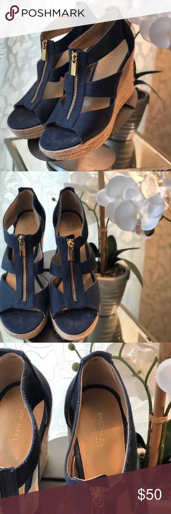 """ Micheal Kors Navy Wedge Sandals Good Condition!!! Worn a few times! Gorgeous Micheal Kors Navy Wedge Sandals w/ Gold Zipper Shoe Color: Navy and Tan Heel height - 4"""" Size - 9 M(US) MICHAEL Michael Kors Shoes Wedges"""