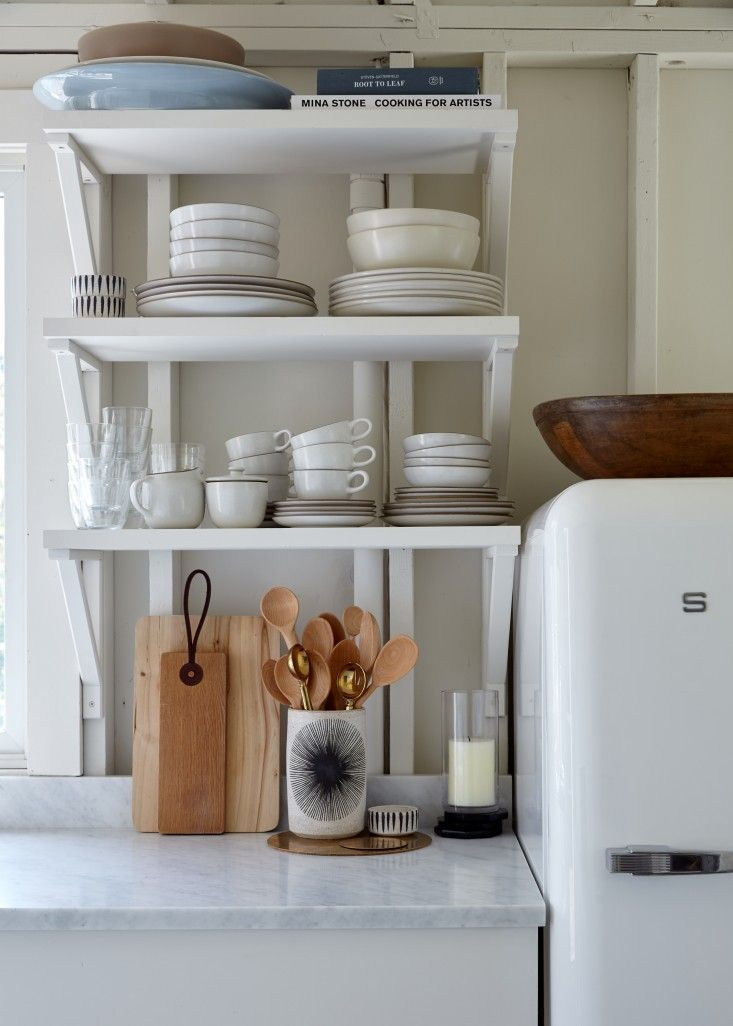 Compact all-white kitchen in Ann Stephenson and Lori Sacco's remodeled Fire Island A-frame, photo by Kate Sears