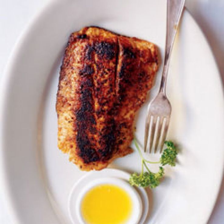 """Paul Prudhomme put this """"Cajun"""" classic—a filet of fish dredged in a flurry of spices and seared in butter—on the culinary map."""