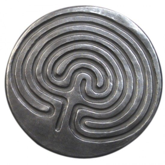 Finger labyrinths for calming children and adults. A former coworker of mine used to walk over to a wall and trace the mortar in the bricks when he became upset.