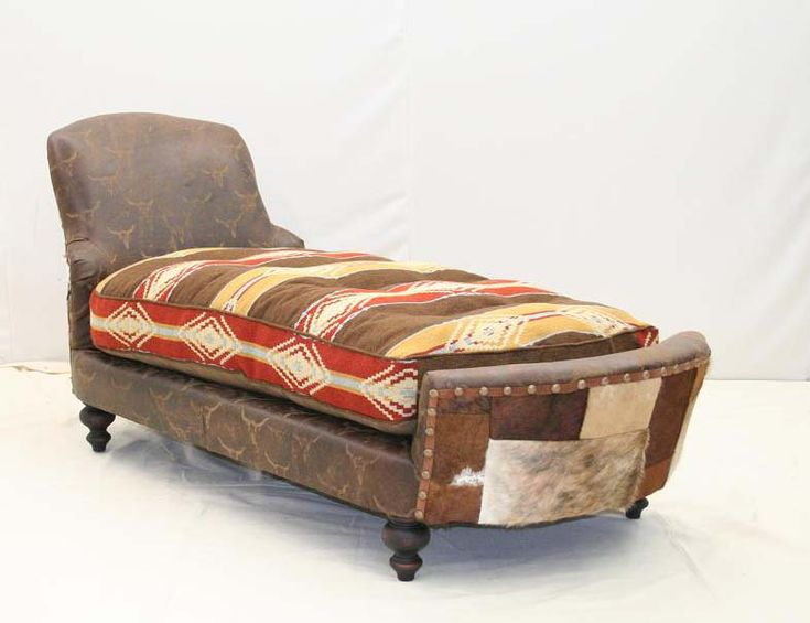 Old Hickory Tannery Ghost Rider Chaise Lounge Western Sofas and Loveseats - Brown leather is transformed with ghost steer images created by hand. Outside of chaise is creative patchwork of hair on hides trimmed with nail heads. The plump seat cushion is Southwestern pattern blanket with leather buttons.