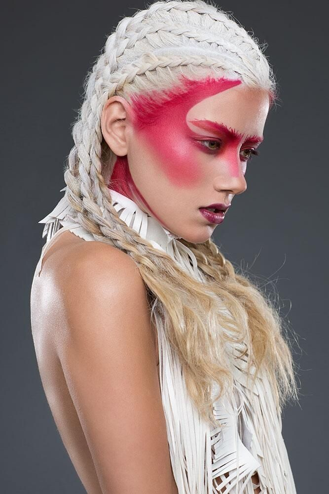 pink spray application makeup and white braided hair