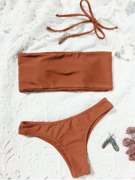 AD : High Cut Bandeau Thong Bathing Suit - BRICK-RED   Chic high cut two piece swimwear feature a bandeau collar top with a padded bust, with straps detail. High leg bikini bottoms designed a thong shape.  Style: Sexy   Swimwear Type: Bikini   Bikini Type: Bandeau Bikini   Gender: For Women   Material: Chinlon   Bra Style: Padded   Support Type: Wire Free   Collar-line: Halter   Pattern Type: Solid Color   Waist: Natural   Elasticity: Elastic   Weight: 0.2200kg   Package: 1 x Top 1 x Briefs