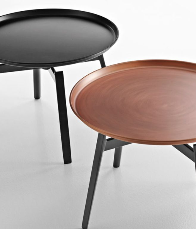 Unveiled at 2013 Salone del Mobile, the new Husk table by Patricia Urquiola for B&B Italia features a copper tray atop die-cast legs....
