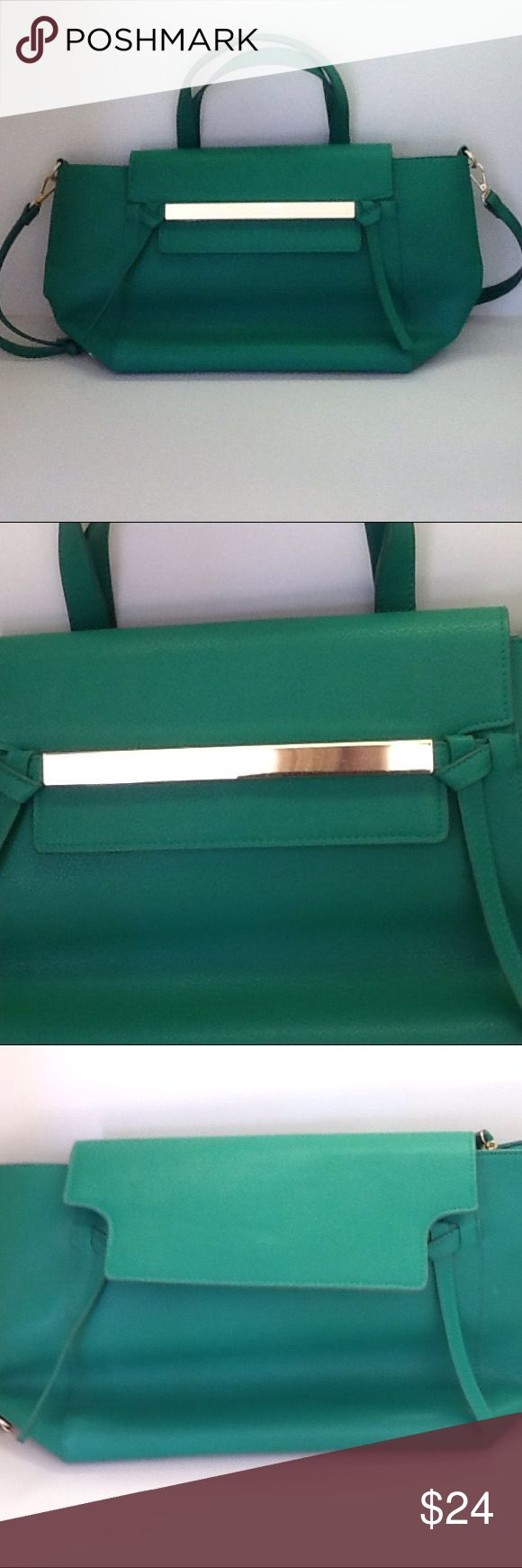 """JustFab Kelly Green Shoulder Bag Excellent condition detachable shoulder strap bag.  Drop is 17"""" -  22"""" with buckle adjustment. Handle drop is 6"""". Bright gold hardware. 8"""" fold-over flap in front. Behind is 6"""" open pocket. 6"""" decorative strips at ends of gold bar.  15"""" zippered closure with pull tab. Inside 7"""" zippered pocket and open pocket on other side. JustFab Bags Shoulder Bags"""