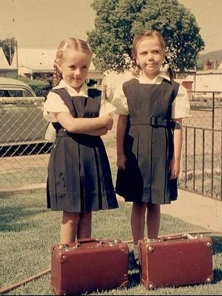 Not looking impressed by their new uniforms, Jenny Collins and friend heading for their first day at school in Wellington. Picture: Supplied by Jim Collins