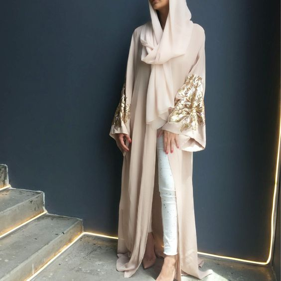Classy white abaya fashion with golden details and white jeans